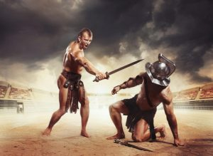 Roman gladiators fighters fighting with sword at coliseum arena. Gladiator won